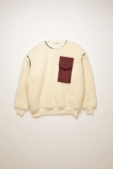 Acne Studios off white sweatshirt is crafted from heavy fleece to an oversized silhouette with contrasting trims and features ripstop buttoned pocket and back panel.