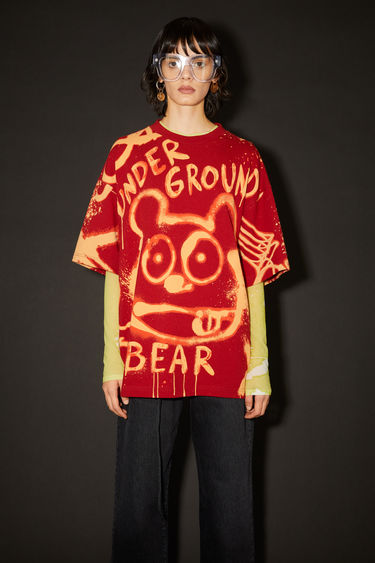 Acne Studios cardinal red crew neck t-shirt is made of organic cotton with an all over bleached print.