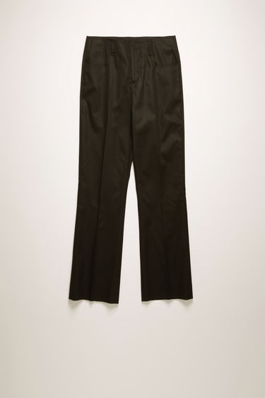 Acne Studios black trousers are shaped to a bootcut fit with neatly pressed creases and finished with raw edges on the waistband.