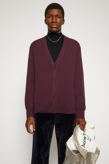Acne Studios burgundy multi cardigan is knitted from fine-gauge merino wool with a melange finish and has a deep v-neckline and four-button closures.