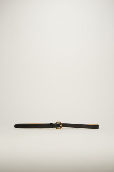 Acne Studios black belt is cut slim from high-shine leather and features an antiqued gold-tone buckle.