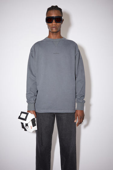 Acne Studios slate grey oversized sweatshirt is made of cotton and features an Acne Studios logo on the front.
