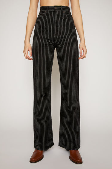 Acne Studios 1990 Black Pinstripe jeans are made from rigid denim and cut to a slim, bootcut-leg shape with a fitted high-rise waist.