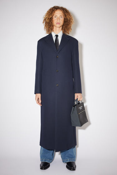 Acne Studios navy tailored, single-breasted long coat is made of cotton and partially lined.