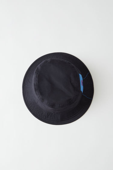 Acne Studios Buk Face Co Tw Flag amber navy blue is a unisex bucket hat with a tonal face patch.