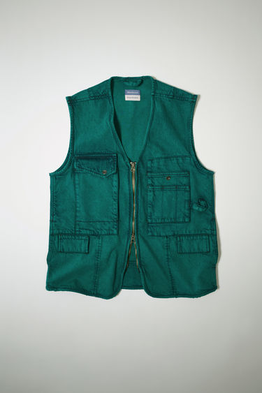 Acne Studios launches an exclusive capsule with NBA basketball player Russell Westbrook. As part of the capsule collection, the jade green utility vest is crafted from acid washed denim and detailed with patch pockets and hammer loops.