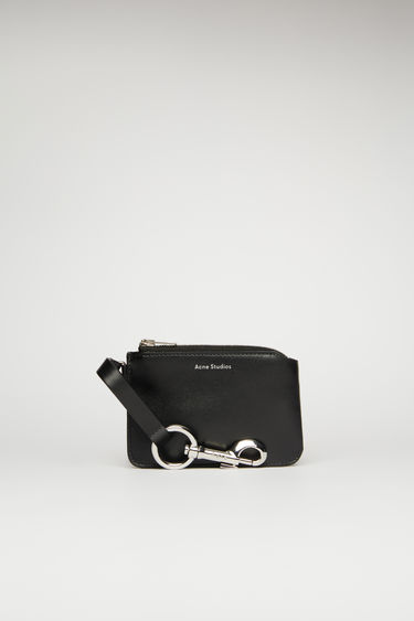 Acne Studios black pouch is crafted from smooth leather and fitted with a lobster clasp that can be attached to bags and belt loops.