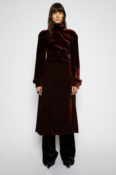 Acne Studios dark brown dress is crafted from fluid velvet to a voluminous silhouette with a mock neck and balloon sleeves, and is nipped-in at the waist before flaring loose over the legs.