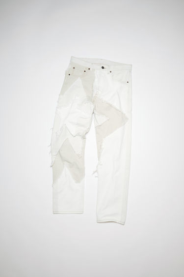 Acne Studios cream/off-white jeans are made from from rigid denim with a high rise and a straight leg, featuring a patchwork star. In collaboration with Ben Quinn.