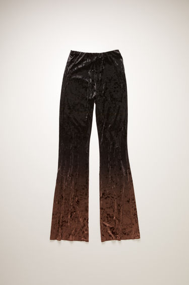 Acne Studios chocolate brown/dark brown trousers are crafted from crushed velvet and features a rich gradient finish. They're shaped with a high-rise elasticated waist with slim legs that flare from the knees.