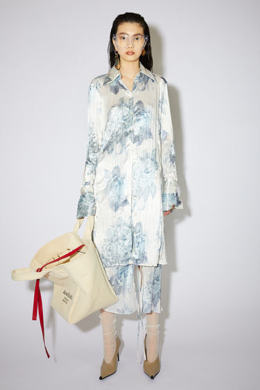 Acne Studios blue long sleeve shiny shirt dress features a pleated floral print and a fitted silhouette.