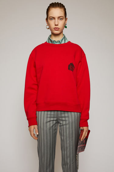 Acne Studios ruby red sweatshirt is crafted from heavyweight brushed jersey and features a print of Acne Studios' headquarter on the chest.