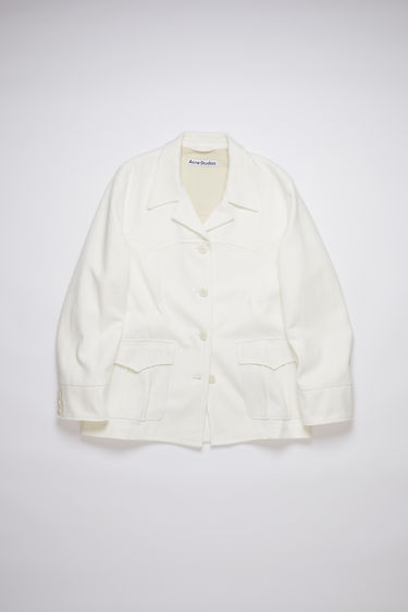 Acne Studios off white unconstructed suit jaket is made of cotton with a relaxed fit.