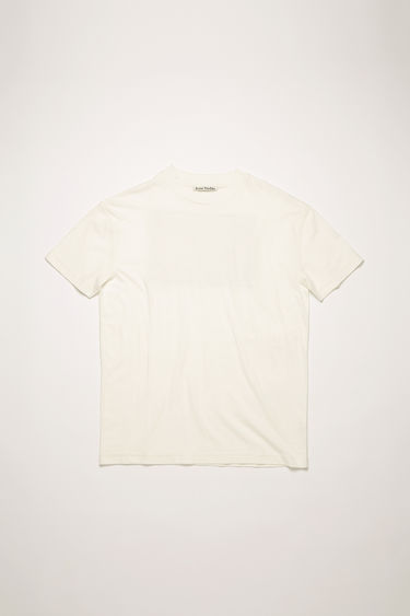Acne Studios optic white t-shirt is crafted from lightweight slub cotton-jersey and adorned with a large-scale label patch that's left with loose threads for a subtle note of texture.
