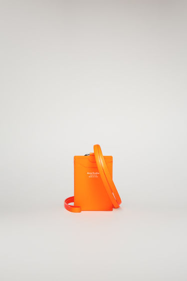 Acne Studios fluo orange lanyard doubles as a cardholder - it's crafted from smooth matte leather and equipped with four card slots and detailed with a contrasting white logo stamp.