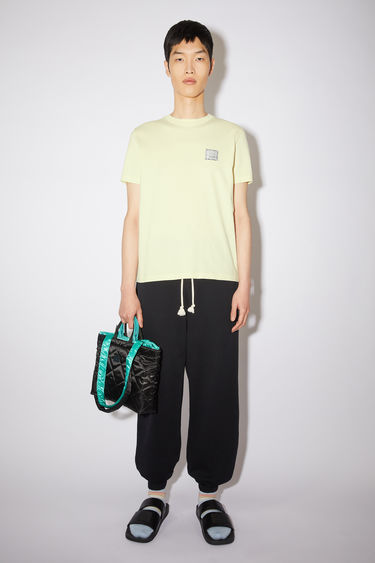 Acne Studios gold cotton jersey t-shirt features a contrasting printed beaded face patch at the chest.