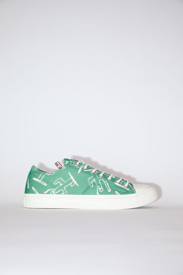 Acne Studios green/off white printed canvas lace-up sneakers have rubber toes and soles.