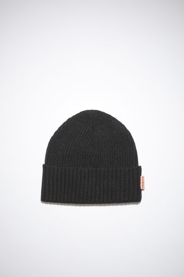 Acne Studios black beanie is knitted from a blend of melange wool yarns in a chunky ribbed pattern and neatly framed with a turn-up brim.