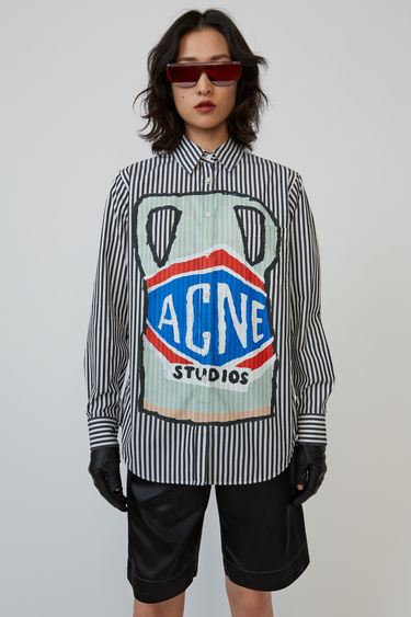 Acne Studios black/white shirt is patterned with breton stripes and features an illustration of Grant Levy-Lucero's ceramic.