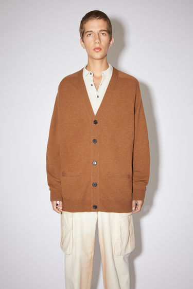 Acne Studios dark camel v-neck cardigan sweater is made of lambswool with rib knit details at the cuffs and hem.