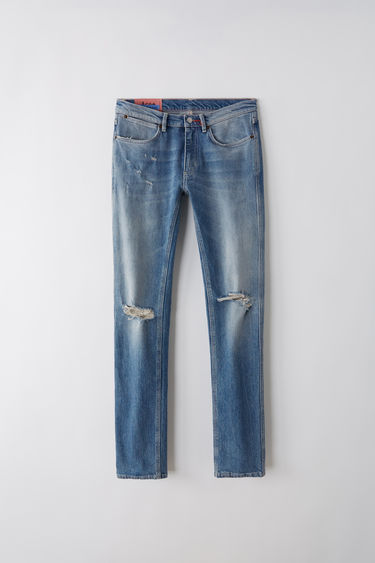 Acne Studios Blå Konst Max mid ripped are slim fit, 5-pocket jeans with a regular length and low waist.