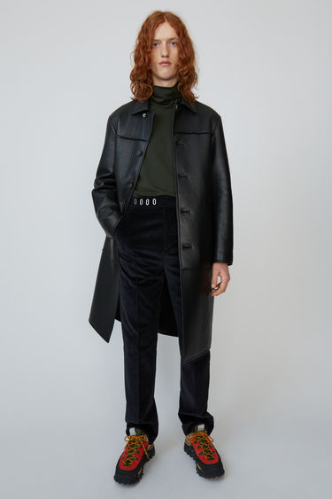 Acne Studios dark navy tailored corduroy trousers with decorative eyelets on the waistband.