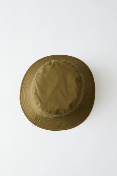 Acne Studios Buk Face Co Tw moss green is a unisex bucket hat with a tonal face patch.