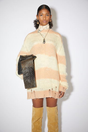 Acne Studios pale yellow/beige textured block stripe sweater has an oversized fit with distressed details.