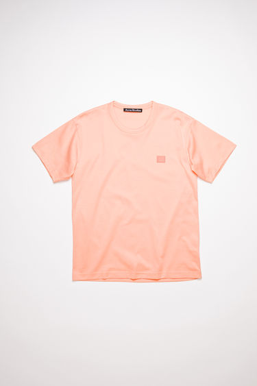 Acne Studios pale pink crew neck t-shirt is made from cotton with a regular fit and a face logo patch.