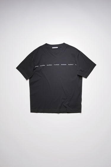 Acne Studios black t-shirt is crafted from organically grown cotton to a relaxed silhouette with a patch pocket and stamped with the house's logo across the chest.