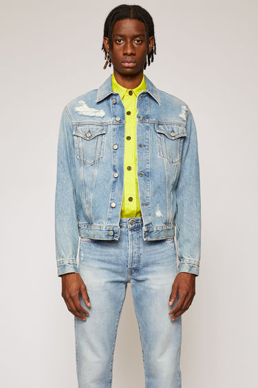 Acne Studios 1998 Blue Patched Up jacket is crafted from washed rigid denim that's purposefully distressed and patched to give a time-worn appeal. It's cut to a slim silhouette with chest patch pockets and accented with branded metal buttons.