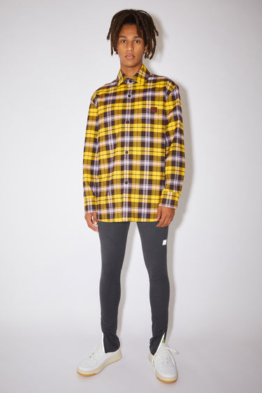 Acne Studios electric yellow/brown checked flannel overshirt is made of cotton with a chest pocket featuring a leather face patch.