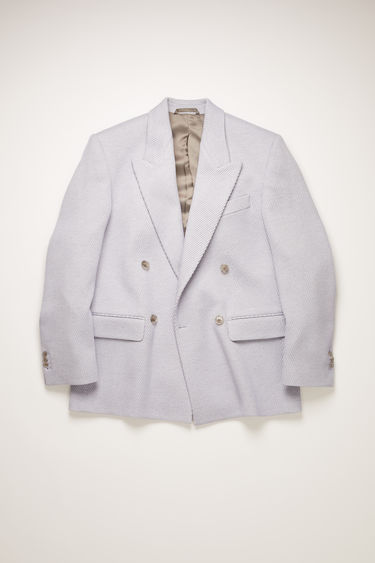 Acne Studios lilac/grey twill suit jacket is constructed to a slightly oversized, boxy shape and has lightly padded shoulders, peak lapels and a double-breasted front.