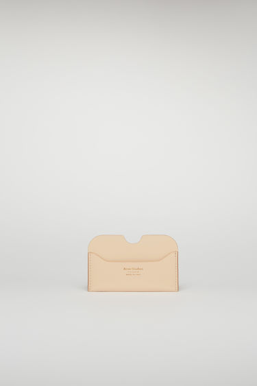 Acne Studios Elmas shiny blush pink cardholder is crafted from high-shine leather and features three card slots with a gold logo stamp at the front.