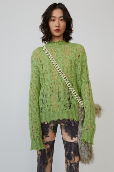 Acne Studios lime green sweater is loosely knitted in a cable-knit pattern and finished with frayed trims.
