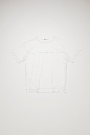 Acne Studios optic white t-shirt is crafted from organically grown cotton to a relaxed silhouette with a patch pocket and stamped with the house's logo across the chest.