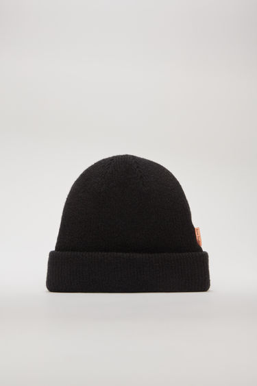 Acne Studios black beanie is rib-knitted from a soft wool-blend and accented with a logo tab on the side seam.