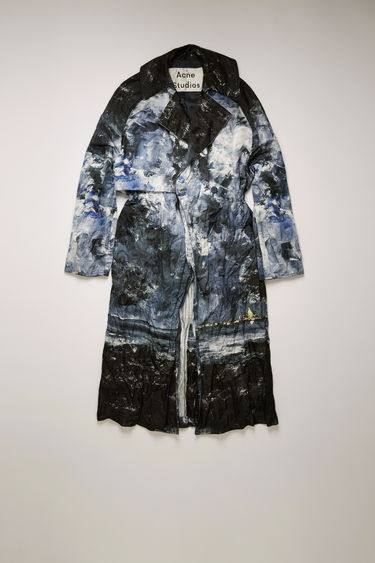 Acne Studios blue/multi double-breasted trench coat is crafted to an oversized fit and features a painting of Swedish nature by August Strindberg with a creased-effect finish. It features classic details, including a drawstring belt, storm flaps, and a single back vent.