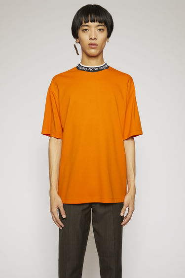 Acne Studios carrot orange t-shirt is crafted to an oversized fit from technical brushed jersey and detailed with a ribbed logo-neck trim.