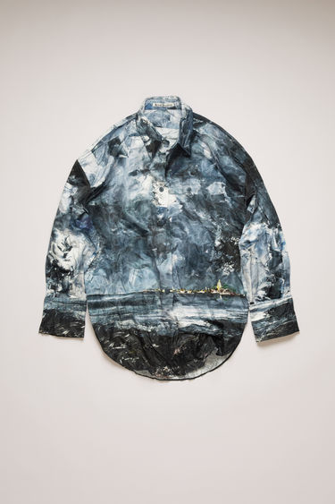 Acne Studios blue/multi shirt is cut to a relaxed fit with creased-effect finish and features a painting of Swedish nature by August Strindberg. It features a chest patch pocket, curved shirttail hem and a drawstring belt to define the waist.