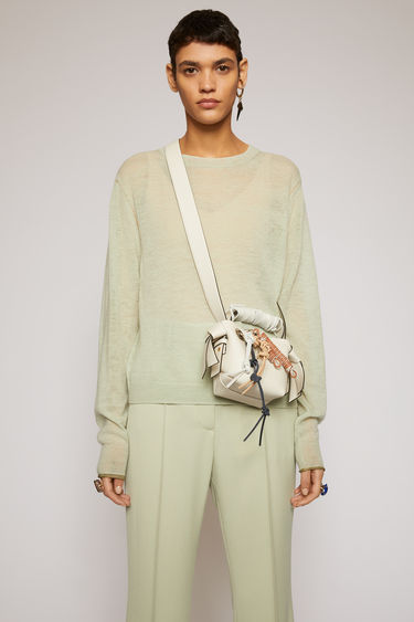 Acne Studios pastel green sweater is knitted from a fine gauge cotton blend and features a patchwork of striped panels. It's shaped to a relaxed fit with a crew neck and dropped shoulder seams.