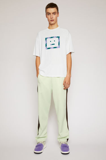 Acne Studios optic white t-shirt is cut to a loose silhouette in cotton jersey and finished with a vichy-check face motif appliqued on front.