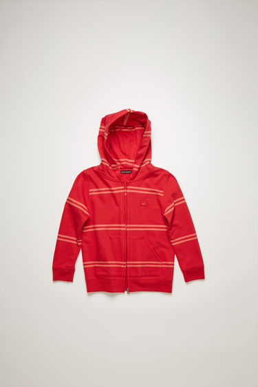 Acne Studios Mini Fairview Str Zip F poppy red is a hooded sweatshirt patterned with double stripes and finished with front pockets and a zip closure.