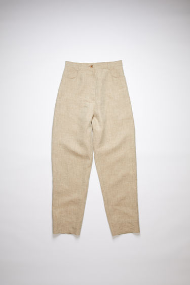 Acne Studios camel melange casual trousers are made of a hemp blend with a dropped crotch fit.