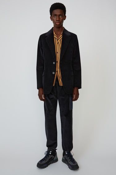 Acne Studios dark navy suit jacket is cut from cotton-corduroy and shaped with wide lapels and padded shoulders.