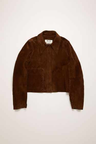Acne Studios chocolate brown suede jacket is crafted to a boxy silhouette with an exaggerated point collar and framed with whipstitching along the sleeves and pocket seams.