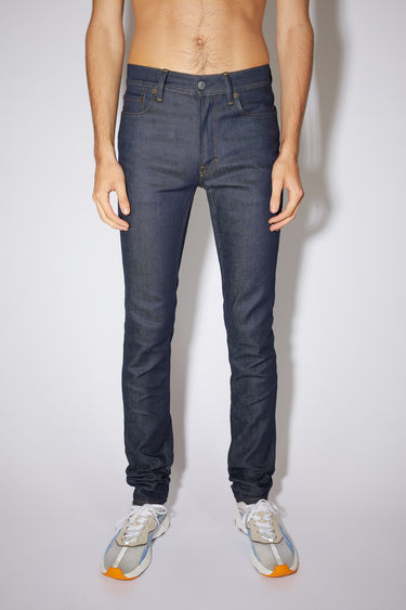 Acne Studios indigo blue jeans are made from comfort stretch denim with a mid rise and a skinny leg.