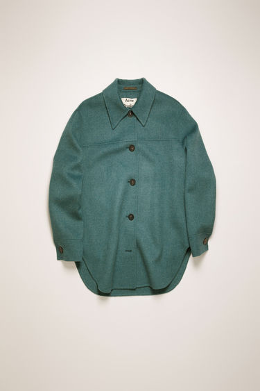 Acne Studios teal blue melange overshirt is crafted from double-faced wool to a relaxed silhouette and features a point collar and a curved hemline.