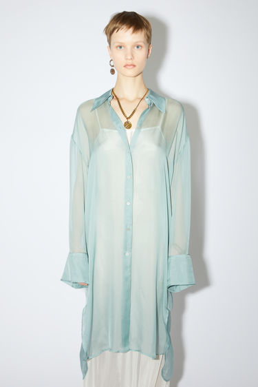 Acne Studios pale blue long sleeve shirt is made of silk chiffon with a relaxed fit.