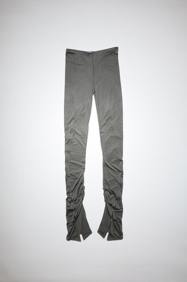 Acne Studios grey elastic waist trousers have shirred, flared legs and ornate metal buttons.